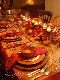 Fall table w gold, orange and brown.