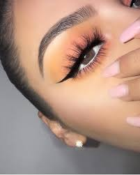 simple colorful eye makeup for hazel brown eyes winged liner and fluffy eye lashes