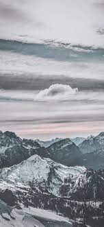 snow capped mountains under white sky ...