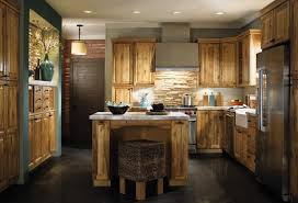 rustic painted kitchen cabinet with stone backsplash and stainless steel refrigerator