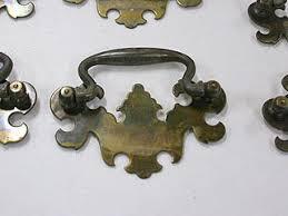 Old brass drawer handles with tarnish around edges