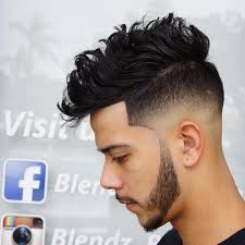 thick wavy men s hairstyle bald fade