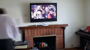 tv wall mount stone fireplace over mounting