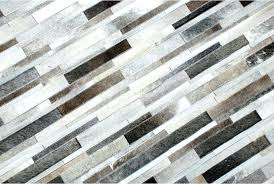 cowhide patch rug top view of a taupe gray cowhide patchwork rug designed in stripes cowhide cowhide patch rug