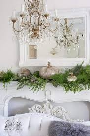 styling a mantel with fresh greenery