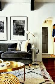 apartments emily henderson designed living room dark velvet grey sofa round coffee table design