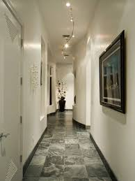 hallway lighting fixtures. amazing hallway with white walls and framed wall picture also track lighting fixtures