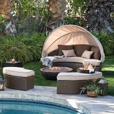 daybed fire pit set with canopy next to pool