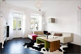 Living Room Black Cowhide Rug With White Wall Paint Colors For Elegant Living  Room ...