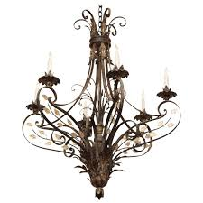 geyser wrought iron six arm chandelier in a gold leaf finish with crystal detail for