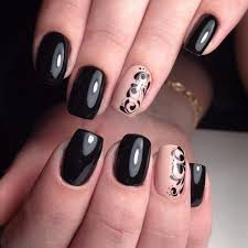 the tribal nail art on black base get your glossy black nails covered with this