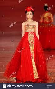 Rose Wedding Dress Designer A Model Displays A Traditional Chinese Bridal Wedding Dress