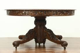 carved quarter sawn oak 60 round antique 1895 dining table 7 leaves