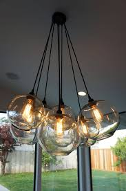 items similar to modern glass globe chandelier w edison lights on