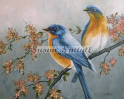 blue birds in flowering tree