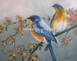 blue birds in flowering tree