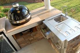 outdoor kitchen by padgetts tile and wood