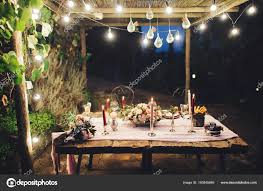 Wedding table lighting Purple Orchid Wedding Decorated Outdoor Wedding Table Flowers Lights Candles Rustic Style Stock Photo Gumtree Decorated Outdoor Wedding Table Flowers Lights Candles Rustic Style