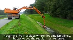 drainage ditch dredging a drainage ditch in the netherlands third time this year