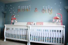 nursery rooms light blue shared sophisticated nursery room decoration with twin convertible cribs and baby name printed wall decal for twin girls