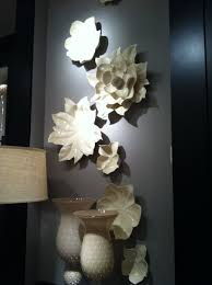 Ceramic wall art and wall sculptures bring vivid beauty to your walls in three dimensions. Ceramic Magnolia Wall Art