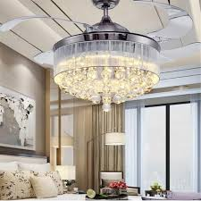 image of ceiling fan and chandelier in same room
