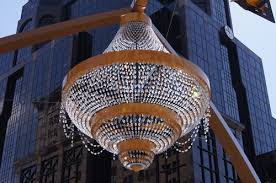 the 20 foot lighting fixture has 4 200 crystal pendants and leds fixtures drawing just 1 700 watts photo courtesy of ge