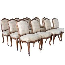 set of 12 antique french carved fruitwood dining chairs for