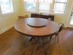 a hand made white oak round dining table with lazy susan c