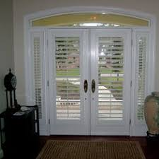 front door blindsPlantation shutters on a front door exterior view  Window