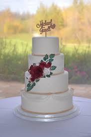 Elegant Rose Gold Wedding Cake With Burgundy Roses Wedding Cake