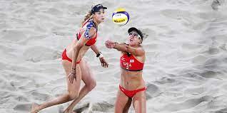 beach volleyball players wear bikinis ...