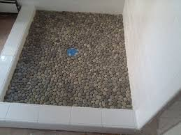 abundant grey glass tile with stone accent wall tiled as well as river decorations