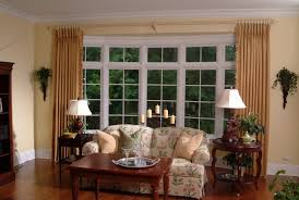 curtain rods for bay windows ideas with two small tables and fl sofa chair