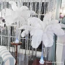 white ostrich feather centerpieces