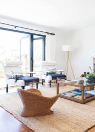 accentuate a neutral room with a jute rug and wicker furniture with navy textiles