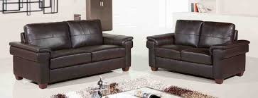 comfortable brown leather couch set with plaid rug for modern white living room