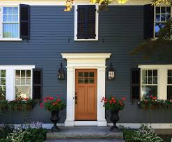 exterior wooden shutters houston. faux / false fake window with shutters in closed position to balance facade of house exterior wooden houston
