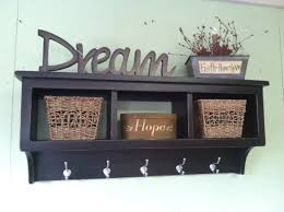 Decorations:Cool Black Wall Shelf For Basket Storage With Metal Coat Hooks  And Green Wall