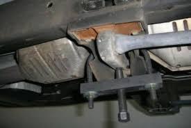 torsion key adjustment bolt. attach u-bolt over cross member and install tool torsion key adjustment bolt t