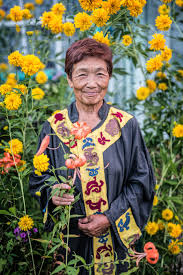 photographer travels the world to capture disappearing cultures a w stands surrounded by wildflowers