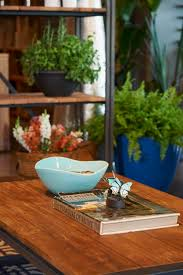 lra rustic coffee table and open shelving from artemano is lightened and brightened with summery blue ceramic ware from homesense 683 1024