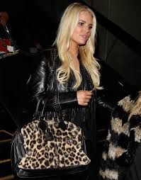 jessica simpson wearing a loose top a pair of trousers saint lau pumps a celine leopard print bag and a roberto cavalli jacket