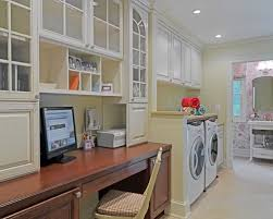 Example of a classic utility room design in DC Metro with raised-panel  cabinets