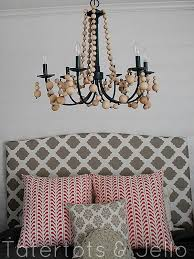 beaded chandelier above the bed