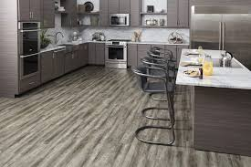 bring one of today s hottest flooring trends to any room of your home with this waterproof floor the neutral grays ashy browns and aged oak design beacon