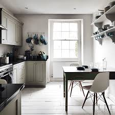 the u shape of this galley kitchen provides extra counter space at each end