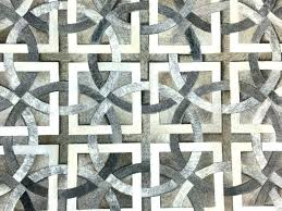 cowhide patchwork rug lifestyle by til in greys off white patch pier one o rug m cowhide patch patchwork nz