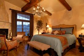 warm master bedroom. Warm And Charming Tuscan Style Master Bedroom With Huge Bed A Bench Decorated Armchairs Chandelier B