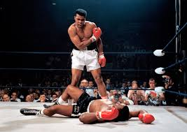 in one of the most iconic and controversial moments of his career ali stands over